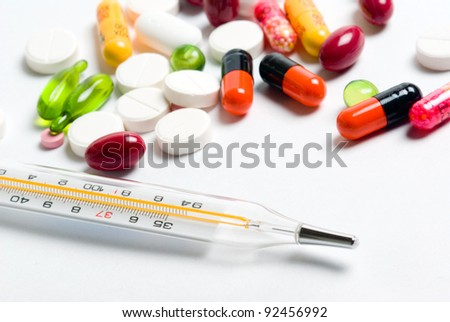Medicine pill with Thermometer - stock photo