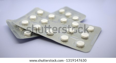 Medicine pills in packs.Pills in blister pack,Capsules and pill packed in blisters, isolated, studio.
