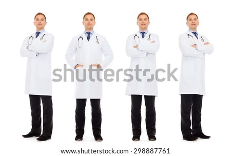 medicine, profession and health care concept - happy doctors with stethoscope