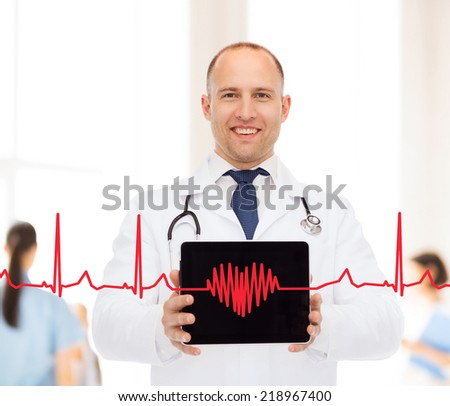 medicine, profession, teamwork and healthcare concept - smiling male doctor with stethoscope showing tablet pc computer screen over blue background #218967400