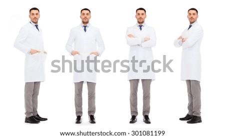 medicine, science, profession and health care concept - doctors in white coat