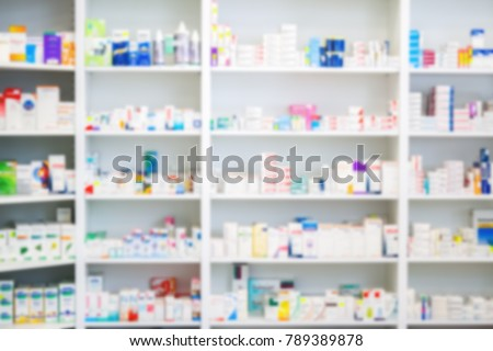 Medicines arranged in shelves at pharmacy out of the focus Pharmacy background photo