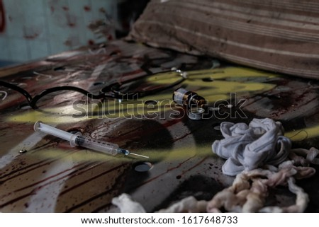 medicines scattered on an old bed of an abandoned madhouse, urbex photography in abandoned places in Italy Stock photo ©