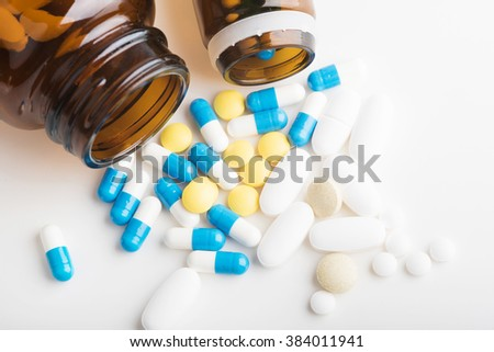 Medicines, supplements and drugs in a bottle on a white background