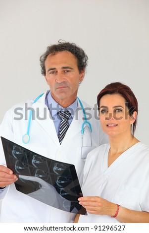 Medics looking at an x-ray