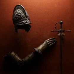 medieval armor made of wrought iron. knight helmet iron medieval age armor, decoration in historical museum.