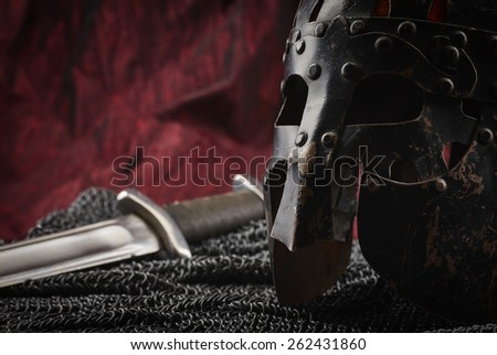 Medieval armour, helmet and sword, red canvas background #262431860