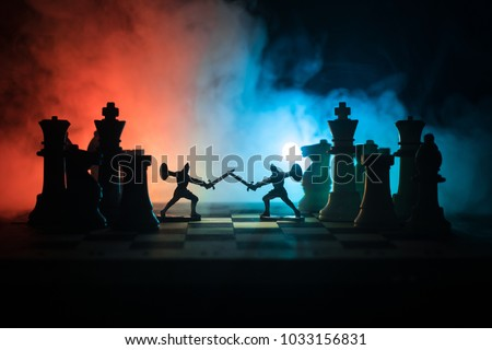 Stock Photo Medieval battle scene with cavalry and infantry on chessboard. Chess board game concept of business ideas and competition and strategy ideas Chess figures on a dark background with smoke and fog.