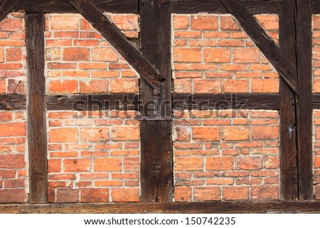 Medieval brick and half-timbered house in Gdansk, Danzig Poland. Background of beams and bricks. Detail of the exterior old building.