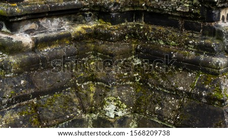 Medieval brickwork covered in grime and moss #1568209738