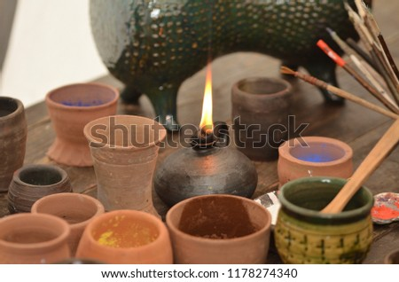 Medieval calligraphy inks - mineral pigments in ceramic pot #1178274340