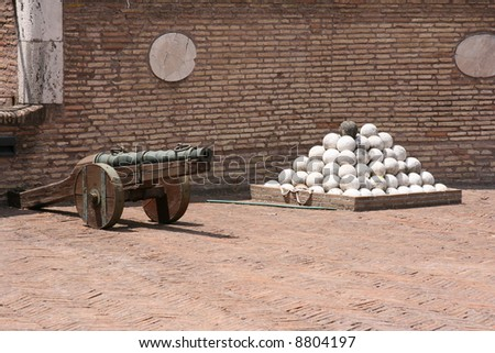 Medieval cannon with set of balls in Rome