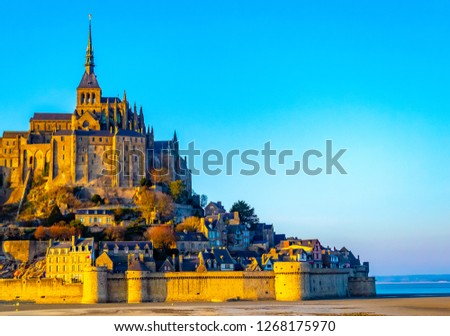 Medieval castle, against the blue sky and white clouds, the castle on the island, the castle is surrounded by water, green grass, a fortress and abbey, an incredibly beautiful castle like  fairy tale #1268175970