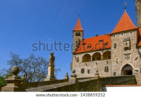 "Medieval Castle ""Bouzov"" a background of the blue sky. Sculpture of Jan Nepomuk. Located in the South Moravia region in Czech republic, Europe. Tourism in Europe. #1438859252"