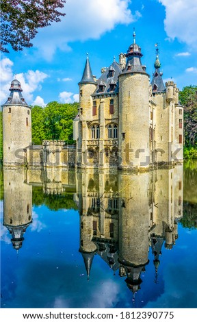 Medieval castle lake reflection in water. Castle lake view. Fairy castle  on water. Castle on water