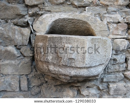medieval castle near Aosta - holy water trough in the castle church
