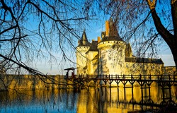 Medieval castle on lake island. Castle view. Castle on water
