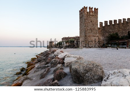 Medieval Castle on the Rocky Beach of Lake Garda in Sirmione, Northern Italy