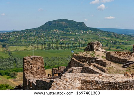 Medieval castle ruins of Szigliget with the Csobanc mountain in the background at Balaton lake in Hungary. Stock photo ©