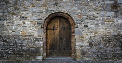 medieval castle wooden door, stone wall panorama