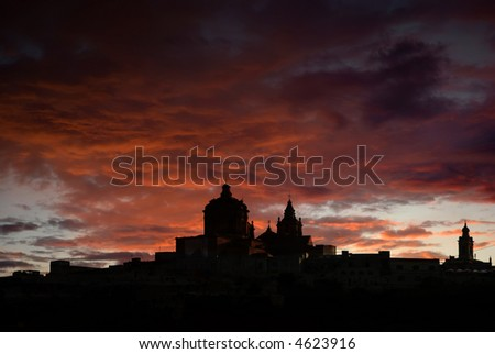 medieval city of Malta in silhouette at sunset