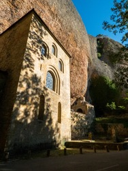 Medieval constructions supported by a large rock in the Monastery of San Juan de la Peña, in the Spanish Pyrenees