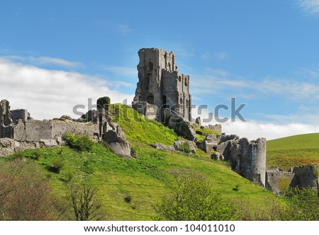 Medieval Corfe Castle in Dorset, England sitting high on a Hillside