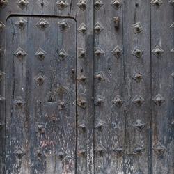Medieval Door. Medieval dilapidated door in Toledo.
