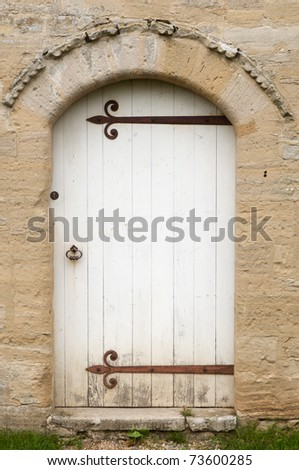 Medieval doorway with wrought iron work - stock photo