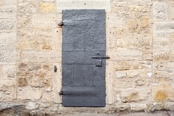 Medieval Dungeon Door on an antique German Castle Wall.
