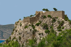 Medieval fortress of Monolithos on a rocky cliff built by the Crusaders in the 15th century (Rhodes, Greece)