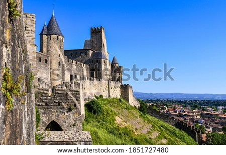 Photo of  Medieval fortress wall towers view. Fortress. Medieval fortress landmark. Medieval fortress wall
