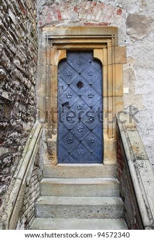 Medieval front door in the downtown of Prague, Czech Republic