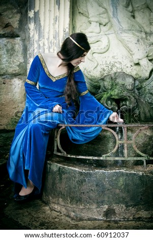 medieval girl next ancient spring
