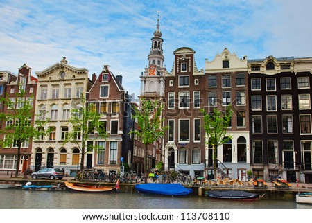 medieval houses on canal in Amsterdam, Netherlands - stock photo