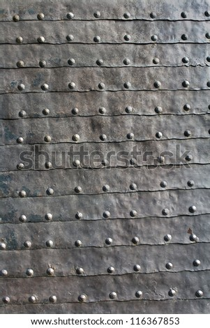 Medieval iron door texture as background - stock photo