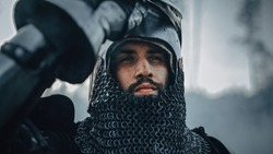 Medieval Knight on Battlefield, Looking at Camera, his Helmet is Open. Portrait of Mighty Warrior, King, Soldier at War, Conquest, Crusade. Dramatic Scene, Cinematic Historic Reenactment