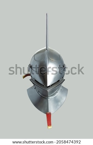 Medieval knightly Milanese helmet with a heraldic kleinod in the form of a swan and a crown, period of the 15th century, on a light background.
