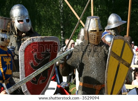Medieval knights with swords and shields