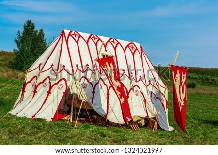 Medieval military camp, marching houses, knights camp. Historic reconstruction concept, reconstruction of the medieval camp.
