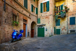 Medieval narrow street in Siena, Province of Siena, Tuscany, Italy. Architecture and landmarks of Siena. Cozy cityscape of Siena