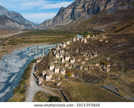 Medieval necropolis city of the dead in the mountains of the Caucasus. North Ossetia. Aerial photo on a drone.