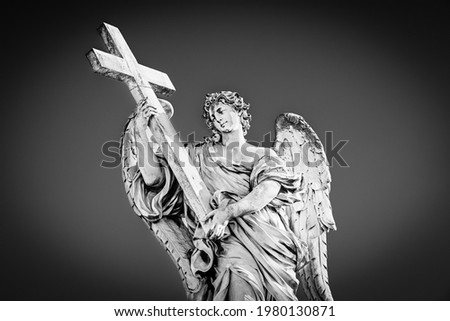 Medieval outdoor statue of an Angel with the Cross on Sant'Angelo Bridge in black and white with vignetting effect in Rome, Lazio region, Italy Stockfoto ©