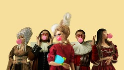 Medieval people as a royalty persons in vintage clothing blowing bubble gum on yellow background. Concept of comparison of eras, modernity and renaissance, baroque style. Creative collage.