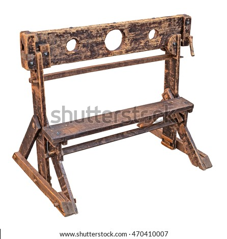medieval pillory, ancient device used for punishment by public humiliation and physical abuse - old wooden stocks isolated with clipping path Stockfoto ©