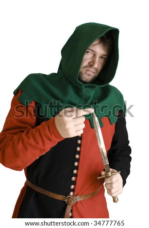 Medieval robber in an ancient red and black suit checks an edge of a knife