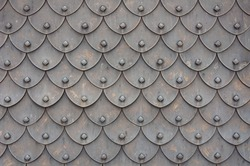 Medieval rusty metal grey scales armor background. Template for border, frame design.