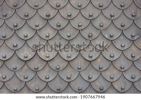 Medieval rusty metal grey scales armor background. Template for border, frame design. Stock photo ©