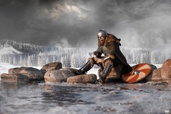 Medieval Scandinavian warrior Viking in full outfit on shore of winter sea