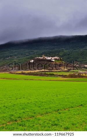 Medieval Spanish City on a Hill, Rainy Day - stock photo